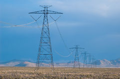 Electricity lines in desert. Electricity towers, lines in Utah desert royalty free stock images
