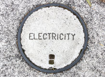 Electricity manhole cover. Royalty Free Stock Photography