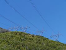 Electricity masts. In the snowy mountains in Australia stock photo
