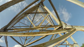 Electricity metal tower construction and clouds motion. Timelapse 4K stock footage