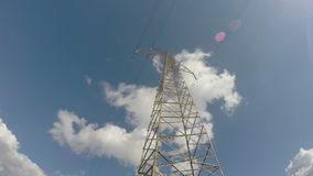 Electricity metal tower construction and clouds motion. Timelapse 4K stock video