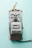 The electricity meter on the wall Royalty Free Stock Images