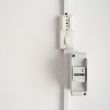 Electricity meter in a white wall Stock Photography