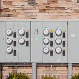 Electricity meters on  a brick wall. Stock Photo
