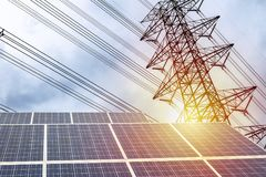 Electricity is solar panel, high-power electric pole. Electricity is a necessity for living. A large solar panel is the front. The backdrop is a high-power royalty free stock photos