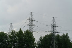 Electricity network against a background of dark rainy sky Stock Images