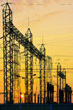 Electricity network at transformer station in sunrise, vertical royalty free stock images