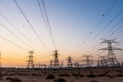 Electricity overhead power lines in the desert. At sunset stock photo