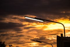 Electricity in parking at sunset. Royalty Free Stock Images