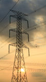 Electricity pillar in sunset Stock Images