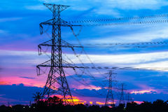 Electricity Pillars against colorful sunset Royalty Free Stock Photo