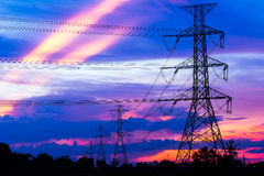 Electricity Pillars against colorful sunset Stock Images