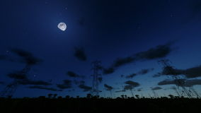 Electricity pillars at night, timelapse clouds, fish eye, stock footage stock video