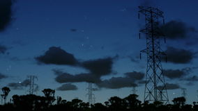 Electricity pillars at night, timelapse clouds, stock footage stock footage