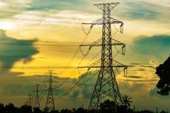 Electricity Pillars at sunset Stock Image