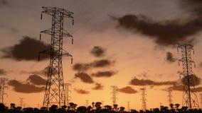 Electricity pillars, timelapse sunrise, camera panning, stock footage stock footage