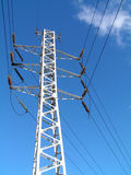 Electricity pilon and cabling at blue sky 2. Electricity pilon and cabling at blue sky with few clouds (winter Royalty Free Stock Photo