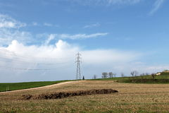 Electricity pilon. A field with electricity pylon royalty free stock photos
