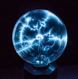 Electricity in a plasma ball Stock Photos