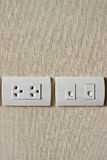 Electricity plug and Phone outlet Royalty Free Stock Images