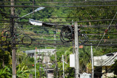 Electricity pole cables bonded in a intersection. Electricity cables in phuket, thailand. close up on the electricity pillar and cable intersections Stock Photos
