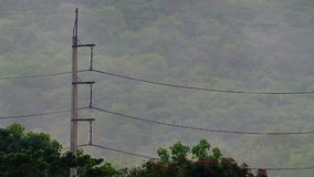 Electricity pole with mountain background stock video footage