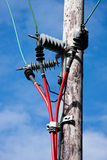 Electricity Pole With Red Cables Royalty Free Stock Photos