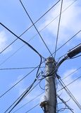 Electricity pole with telephone wires Stock Image