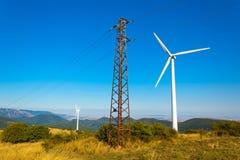 Electricity pole and wind. Windmills on the ridge of Stara Planina Royalty Free Stock Photos