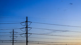 Electricity poles on colorful sky Royalty Free Stock Images