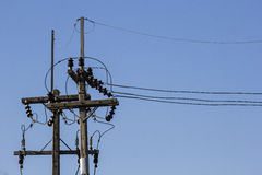 Electricity poles and electrical insulation Stock Photo