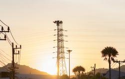 Electricity poles evening sky yellow. Stock Photos