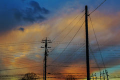 electricity poles at sunset with colorful cloud Royalty Free Stock Photo