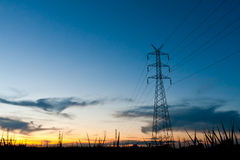 Electricity poles in twilight time Royalty Free Stock Photos