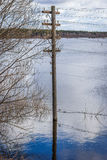 The electricity poles in the water. Flood - the river Mologa. The power line poles in the water. Near the entrance to the village Maksatikha Stock Image