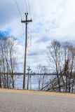The electricity poles in the water. Flood - the river Mologa. And there needs to be fields and now water. The river Mologa was flooded. Near the entrance to the Royalty Free Stock Photography