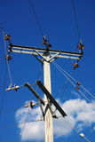 Electricity poles and wires. A background of electrical poles and wires under a bright blue sky stock images