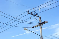 Electricity poles and wires with blue sky Stock Photo