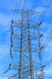 Electricity poles and wires high. High voltage power pole at large . With blue sky Stock Photo
