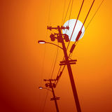 Electricity post. Sunset location background Stock Photos
