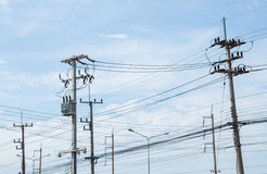 Electricity post and blue sky Stock Images