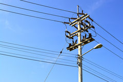 Electricity post on the blue sky. Stock Photos