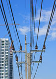 Electricity post and cable line with blue sky Royalty Free Stock Photo