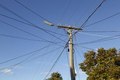 Electricity Post with Cable Lines Attached Royalty Free Stock Photography
