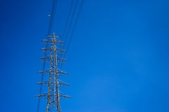Electricity post and clear blue sky Royalty Free Stock Images