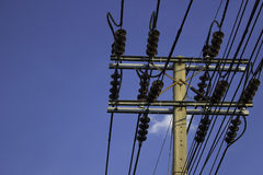 Electricity post with clear blue sky Royalty Free Stock Photo