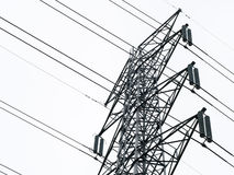 Electricity post. Closeup of electric pole tower isolated on white background Royalty Free Stock Photo
