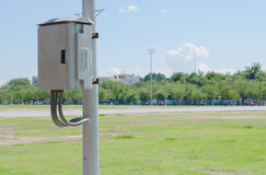 Electricity post and control box in the park. Royalty Free Stock Photos