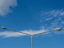 Electricity post duo with blue sky background Royalty Free Stock Image