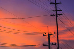 Electricity post in evening Stock Photo